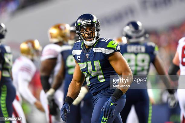 Bobby Wagner of the Seattle Seahawks looks at the scoreboard after a San Francisco 49ers field goal in the second quarter of the game at CenturyLink...