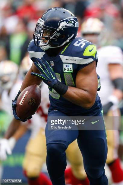 Bobby Wagner of the Seattle Seahawks runs the ball after a fumble recovery in the second quarter against the San Francisco 49ers at CenturyLink Field...