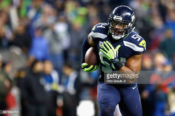 Bobby Wagner of the Seattle Seahawks runs with the ball on his way to scoring a touchdown during the fourth quarter after recovering a fumble by...