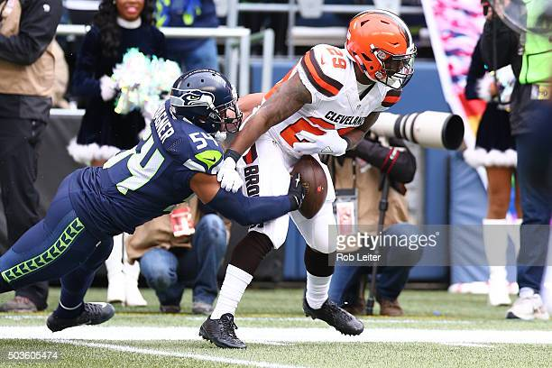 Bobby Wagner of the Seattle Seahawks strips the ball from Duke Johnson Jr #29 during the game against the Cleveland Browns at CenturyLink Field on...
