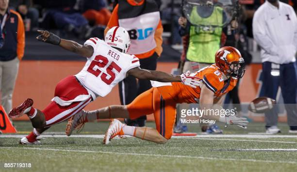 Bobby Walker of the Illinois Fighting Illini reaches to catch the pass as Antonio Reed of the Nebraska Cornhuskers defends at Memorial Stadium on...