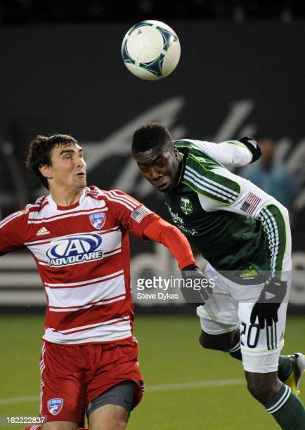 Bobby Warshaw of FC Dallas battles with Jose Adolfo Valencia of the Portland Timbers in front of the goal during the first half of the game at...