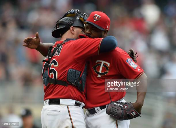Bobby Wilson and Fernando Rodney of the Minnesota Twins celebrate defeating the Texas Rangers after the game on June 24 2018 at Target Field in...