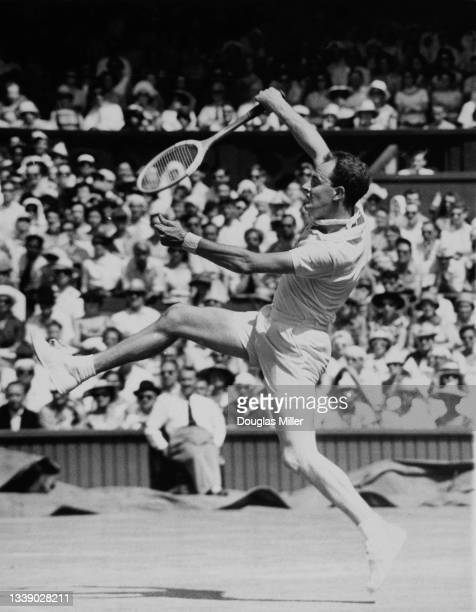 Bobby Wilson of Great Britain reaches to play an overhead return to Neale Fraser of Australia during their Men's Singles Fourth Round match at the...