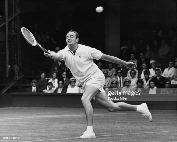 Bobby Wilson of Great Britain reaches to play forehand return to Bill Bowrey of Australia during their Men's Singles Third Round match at the...