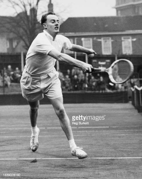 Bobby Wilson of Great Britain reaches to play forehand return to Pablo Eisenberg of the United States during their Men's Singles Quarterfinal match...