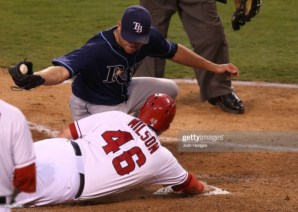 Bobby Wilson #46 of the Los Angeles Angels of Anaheim is tagged out by Matt Moore #55 of the Tampa Bay Rays attempting to steal home on a wild pitch at Angel Stadium of Anaheim on July 28, 2012 in Anaheim, California.