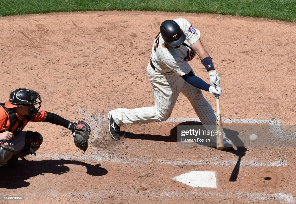 Bobby Wilson #46 of the Minnesota Twins hits an RBI single as Chance Sisco #15 of the Baltimore Orioles catches during the fifth inning of the game on July 7, 2018 at Target Field in Minneapolis, Minnesota. The Twins defeated the Orioles 5-4.