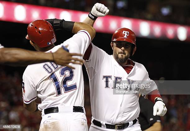 Bobby Wilson of the Texas Rangers is congratulated by Rougned Odor after hitting his first home run as a Ranger during the seventh inning of a...