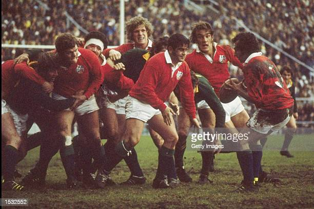 Bobby Windsor of the British Lions feeds the ball to teammate Gareth Edwards during the British Lions first test match against South Africa In South...