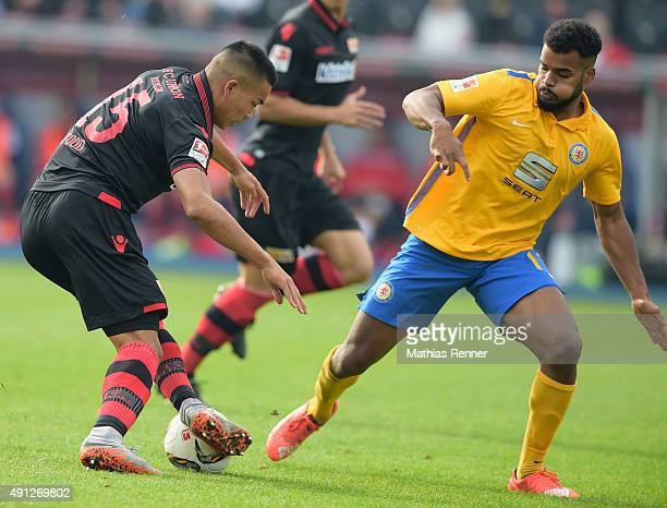 Bobby Wood of 1 FC Union Berlin and Phil OfosuAyeh of Eintracht Braunschweig during the Second Bundesliga match between Eintracht Braunschweig and 1...