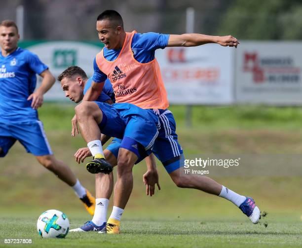 Bobby Wood of Hamburg and Bjarne Thoelke of Hamburg battle for the ball during the Training Camp of Hamburger SV on July 23, 2017 in Laengenfeld,...