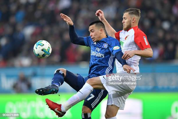 Bobby Wood of Hamburg and Jeffrey Gouweleeuw of Augsburg fight for the ball during the Bundesliga match between FC Augsburg and Hamburger SV at...