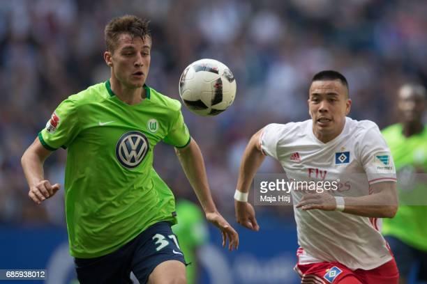 Bobby Wood of Hamburg and Robin Knoche of Wolfsburg battle for the ball during the Bundesliga match between Hamburger SV and VfL Wolfsburg at...