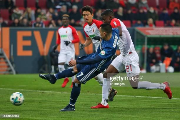 Bobby Wood of Hamburg and Sergio Cordova of Augsburg battle for the ball during the Bundesliga match between FC Augsburg and Hamburger SV at WWKArena...