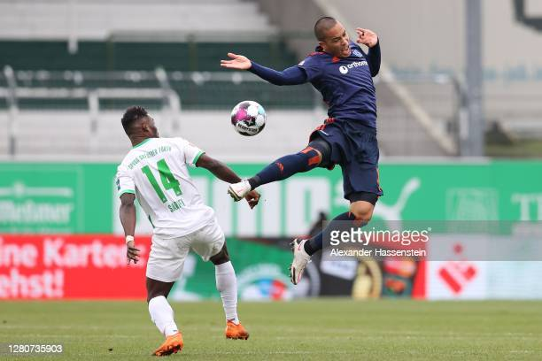 Bobby Wood of Hamburg battles for the ball with Hans Nunoo Sarpei of Fürth during the Second Bundesliga match between SpVgg Greuther Fürth and...