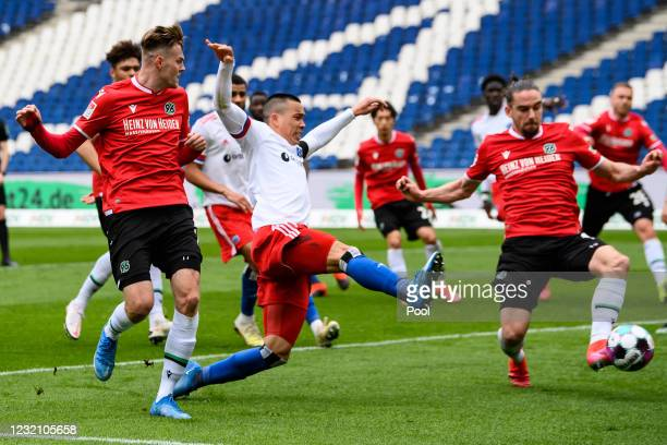 Bobby Wood of Hamburg battles for the ball with Marvin Ducksch and Niklas Hult of Hannover during the Second Bundesliga match between Hannover 96 and...