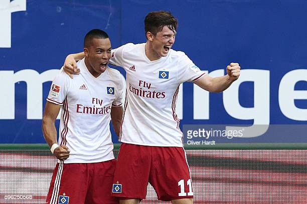 Bobby Wood of Hamburg celebrates scoring the opening goal with his team mates Michael Gregoritsch during the Bundesliga match between Hamburger SV...