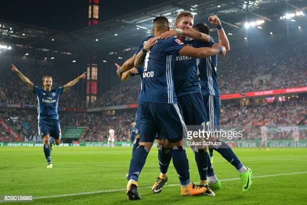 Bobby Wood of Hamburg is being celebrated by his team mates after he scored Hamburg's second goal during the Bundesliga match between 1 FC Koeln and...