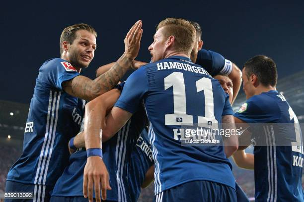Bobby Wood of Hamburg is being celebrated by his team mates Dennis Diekmeier of Hamburg and Andre Hahn of Hamburg after he scored Hamburg's second...