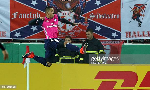Bobby Wood of Hamburg jubilates after scoring the first goal during the DFB Cup second round match between Hallescher FC and Hamburger SV at...
