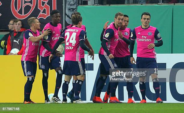 Bobby Wood of Hamburg jubilates with team mates after scoring the first goal during the DFB Cup second round match between Hallescher FC and...