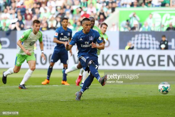 Bobby Wood of Hamburg scores a goal from the penalty spot to make it 01 during the Bundesliga match between VfL Wolfsburg and Hamburger SV at...