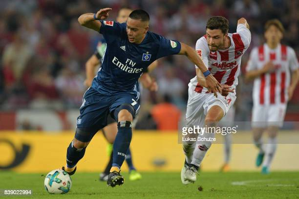 Bobby Wood of Hamburg with Jonas Hector of Koeln during the Bundesliga match between 1 FC Koeln and Hamburger SV at RheinEnergieStadion on August 25...