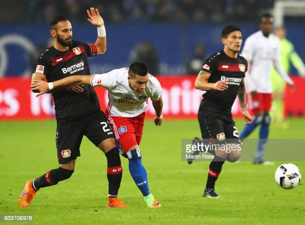 Bobby Wood of Hamburger SV is challenged by Omer Toprak of Bayer Leverkusen during the Bundesliga match between Hamburger SV and Bayer 04 Leverkusen...