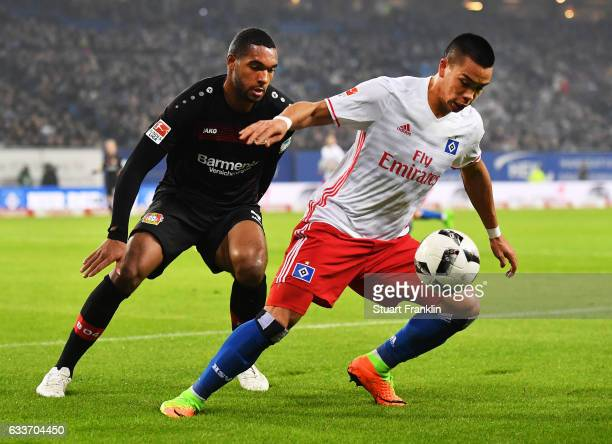 Bobby Wood of Hamburger SV is tracked by Jonathan Tah of Bayer Leverkusen during the Bundesliga match between Hamburger SV and Bayer 04 Leverkusen at...