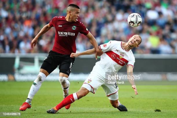 Bobby Wood of Hannover and Holger Badstuber of Stuttgart compete for the ball during the Bundesliga match between Hannover 96 and VfB Stuttgart at...