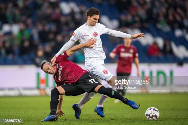 Bobby Wood of Hannover challenges for the ball with Marcin Kaminski of Düsseldorf during the Bundesliga match between Hannover 96 and Fortuna...