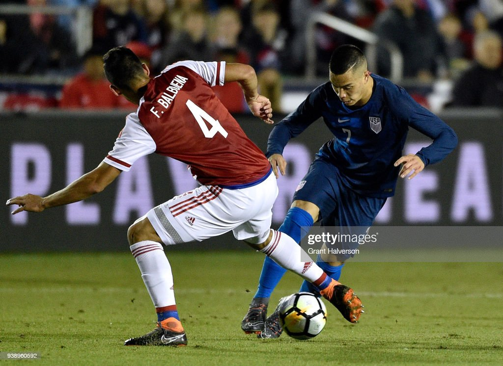 Bobby Wood #7 of United States moves the ball against Fabian Balbuena #4 of Paraguay during their game at WakeMed Soccer Park on March 27, 2018 in Cary, North Carolina.