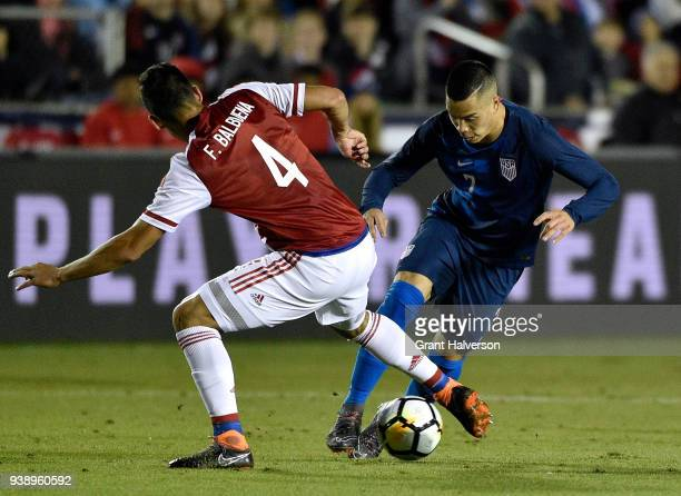 Bobby Wood of United States moves the ball against Fabian Balbuena of Paraguay during their game at WakeMed Soccer Park on March 27 2018 in Cary...