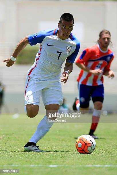 Bobby Wood of USA drives the ball during an international friendly match between Puerto Rico and USA at Juan Ramon Loubriel Stadium on May 22 2016 in...