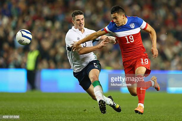 Bobby Wood of USA runs at Ciaran Clark of Ireland during the International Friendly match between the Republic of Ireland and USA at the Aviva...