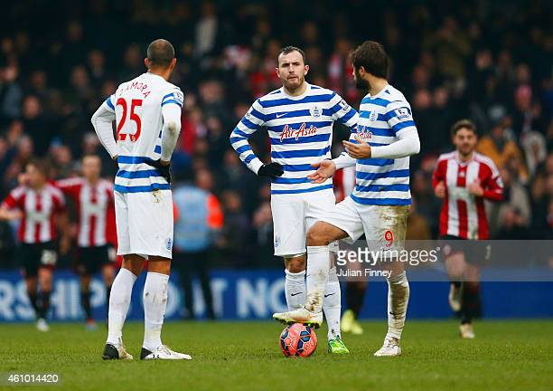 Bobby Zamora Jordan Mutch and Charlie Austin of QPR look dejected as Jamal CampbellRyce of Sheffield United scores their third goal during the FA Cup...