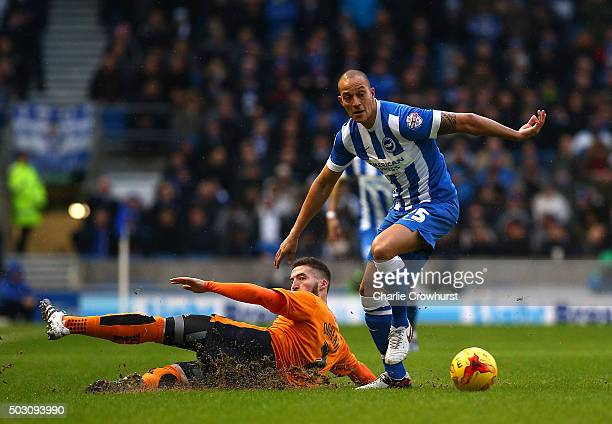 Bobby Zamora of Brighton gives Wolves Matt Doherty the slip during the Sky Bet Championship match between Brighton and Hove Albion and Wolverhampton...