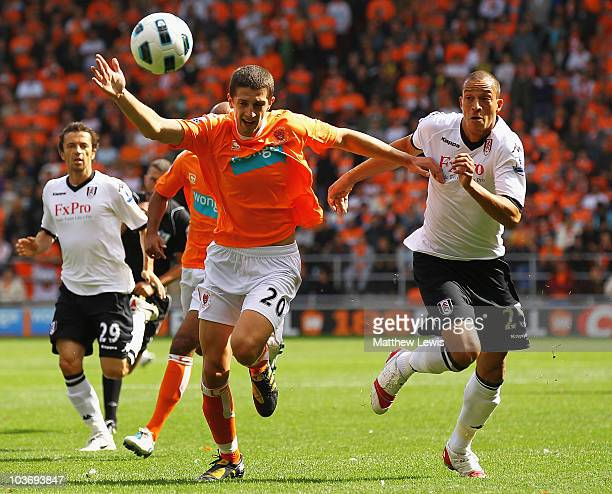 Bobby Zamora of Fulham and Craig Cathcart of Blackpool challene for the ball during the Barclays Premier League match between Blackpool and Fulham at...
