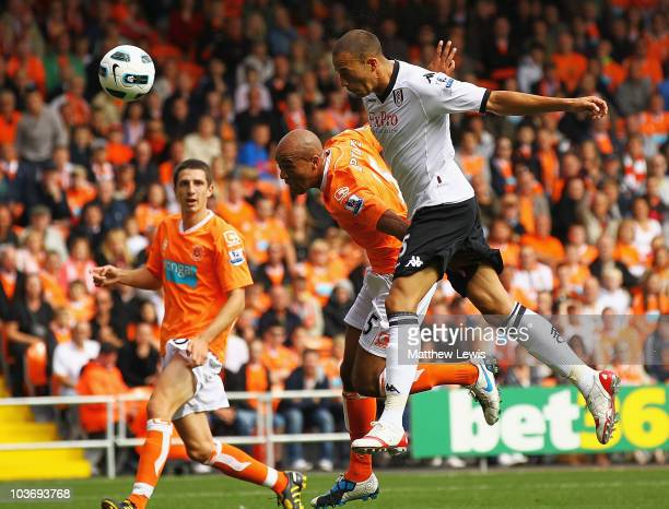 Bobby Zamora of Fulham beats Alex Baptiste of Blackpool to score a goal during the Barclays Premier League match between Blackpool and Fulham at...