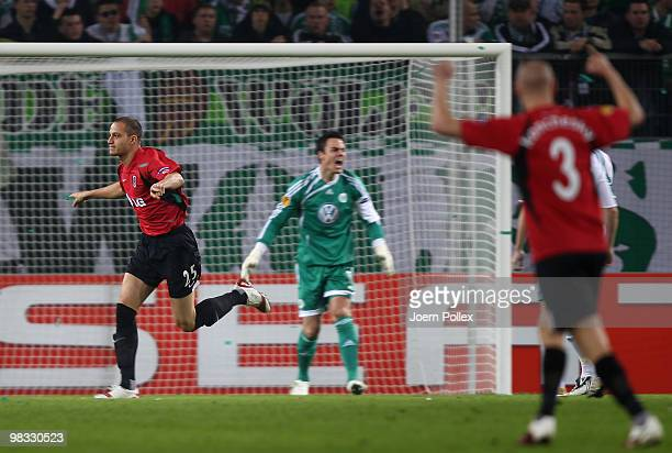 Bobby Zamora of Fulham celebrates after scoring his team's first goal during the UEFA Europa League quarter final second leg match between VfL...