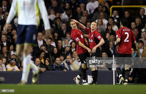 Bobby Zamora of Fulham celebrates scoring the first goal during the FA Cup Quarter Final Replay match between Tottenham Hotspur and Fulham at White...