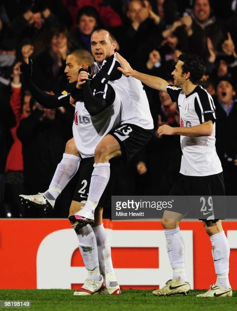 Bobby Zamora of Fulham celebrates with Danny Murphy and Simon Davies as he scores their first goal during the UEFA Europa League quarter final first...