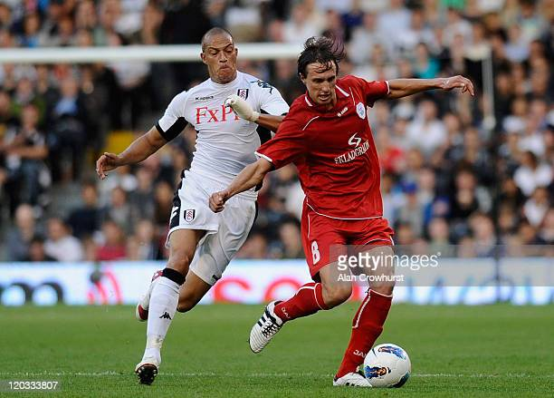 Bobby Zamora of Fulham fights for the ball with Ante Vitaic of RNK Split during the UEFA Europa League 3rd Qualifying Round 2nd Leg match between...