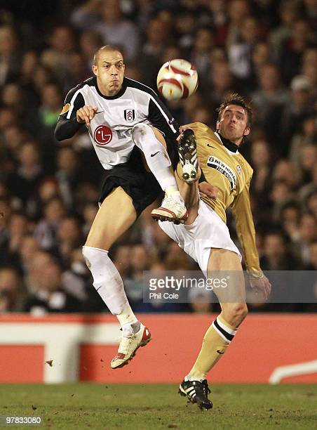 Bobby Zamora of Fulham is challenged by Zdenek Grygera of Juventus during the UEFA Europa League Round of 16 second leg match between Fulham and...