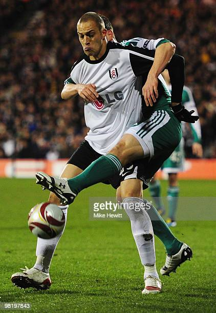 Bobby Zamora of Fulham tangles with Andrea Barzagli of VfL Wolfsburg during the UEFA Europa League quarter final first leg match between Fulham and...