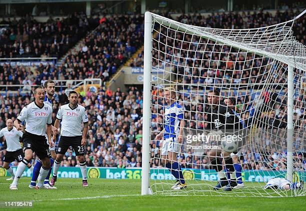 Bobby Zamora of Fulham watches as teammate Brede Hangeland's shot beats goalkeeper Ben Foster of Birmingham City during the Barclays Premier League...