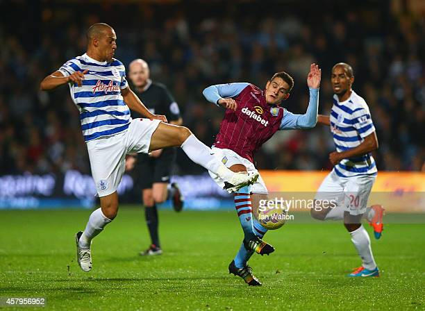 Bobby Zamora of QPR and Ashley Westwood of Aston Villa battle for the ball during the Barclays Premier League match between Queens Park Rangers and...