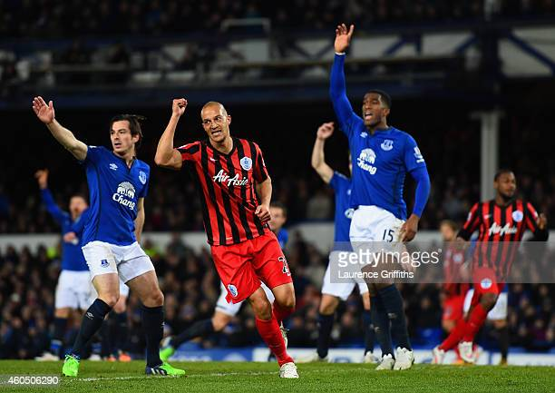 Bobby Zamora of QPR celebrates scoring their first goal as Leighton Baines and Sylvain Distin of Everton appeal during the Barclays Premier League...