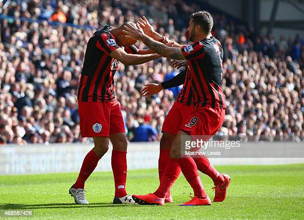 Bobby Zamora of QPR celebrates scoring their third goal with Charlie Austin of QPR during the Barclays Premier league match West Bromwich Albion and...